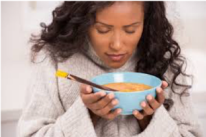 woman holding bowl of food