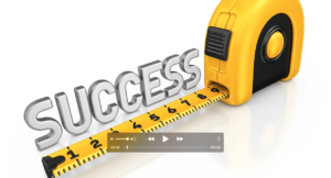 measuring tape with the word success