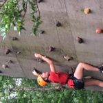 child climbing on climbing wall