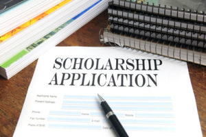 scholarship application with a pen and books
