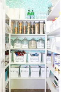pantry organized with bins and containers or food items